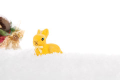 Christmas rabbit on the snow Stock Photos