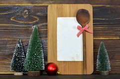 Christmas recipe card. On wooden background Royalty Free Stock Image