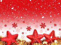 Christmas red star decorations and snowfall stock photos