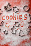 Christmas red background with cutters for cookies Stock Images
