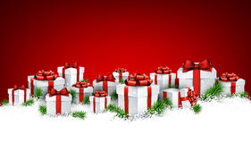 Christmas red background with gift boxes. Abstract red christmas background with fir branches and realistic gift boxes. Vector illustration Stock Photos