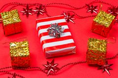 Christmas red background with gift and decoration Royalty Free Stock Image