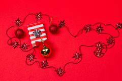 Christmas red background with gift and decoration Royalty Free Stock Photography