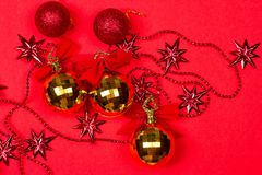 Christmas red background with gift and decoration Royalty Free Stock Images
