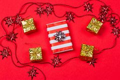 Christmas red background with gift and decoration Royalty Free Stock Photos