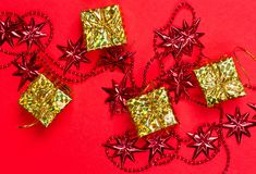 Christmas red background with gift and decoration Stock Photos