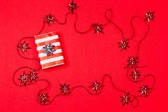 Christmas red background with gift and decoration Stock Photo