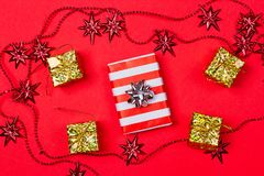 Christmas red background with gift and decoration Stock Photography