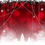 Christmas red background with hanging stars and trees Stock Image