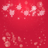 Christmas red background with hanging white snowflakes decorations Royalty Free Stock Photos
