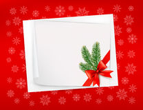 Christmas red background with sheet of paper and r. Ed bow and ribbon. Vector Royalty Free Stock Images