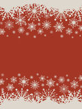 Christmas red background with snowflakes. Stock Photos