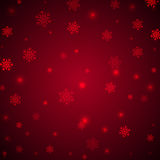 Christmas red background with snowflakes and glitter Stock Photo