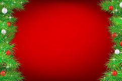 Christmas red background with spruce twigs and christmas balls Royalty Free Stock Images