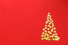 Christmas red  background with stars tree Royalty Free Stock Photo