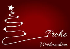 Christmas red background with white Christmas tree. And wish written in German language, Frohe Weihnachten Royalty Free Stock Photo