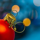 Christmas red ball on the background of the light spots, close-up. stock photography