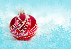 Christmas red ball on blue background. Christmas red ball, blue background with snowflakes  for holidays card and cover Stock Images