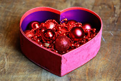 Christmas red ball in a box shape heart Royalty Free Stock Image