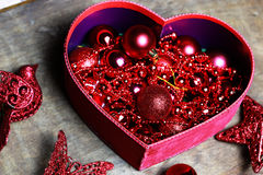 Christmas red ball in a box shape heart Royalty Free Stock Images