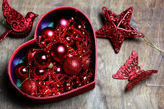 Christmas red ball in a box shape heart Stock Images