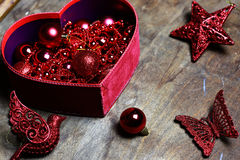 Christmas red ball in a box shape heart Stock Image
