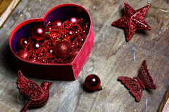 Christmas red ball in a box shape heart Stock Photos