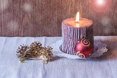 Christmas ball, candle and pine cones. Selective focus Stock Images