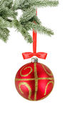 Christmas red ball and christmas tree branch isolated over white Royalty Free Stock Images