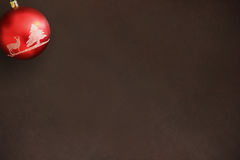 Christmas red ball on dark wooden table Royalty Free Stock Photography