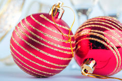 Christmas red ball with golden glitter. Christmas red ball with golden stripes Royalty Free Stock Photo