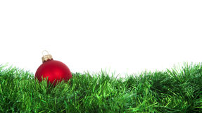 Christmas red ball on green decoration. Christmas red ball on green shower of sparks Stock Photos