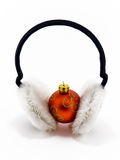 Christmas red ball with headphones on white. Christmas red ball with black and white headphones on white Stock Photography