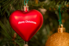 Christmas red ball, heart-shaped Royalty Free Stock Image