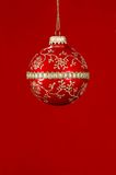 Christmas Red Ball Ornament. With red background royalty free stock photos