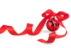 Christmas red ball with ribbon Stock Image