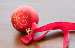 Christmas red ball with ribbon Royalty Free Stock Photo