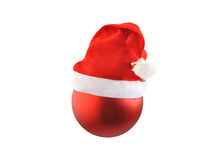 Christmas red ball with Santa hat on white. Stock Photo