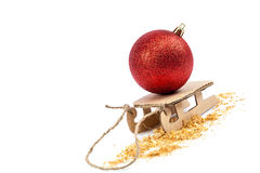 Christmas red ball on a sled. New Year's theme. Stock Image