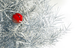 Christmas red ball on snowy conifer stock photos