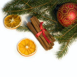 Christmas red ball, twig of fir, orange and  cinna Stock Photos