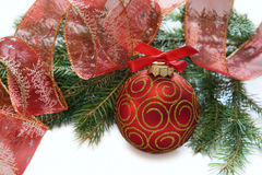 Christmas red ball, twig of fir , ribbon Stock Photos