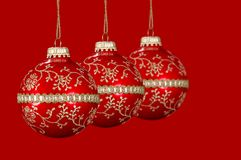 Christmas Red Balls. With red background stock image