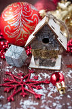 Christmas red balls, bird-house, snowflakes and sn Stock Photos
