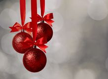 Christmas red balls and bow over magic bokeh royalty free stock photography