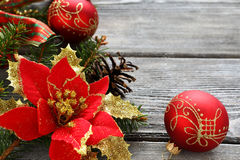 Christmas red balls with bows on the boards Royalty Free Stock Photo