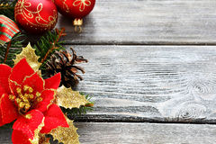 Christmas red balls with bows on a wooden board Stock Image