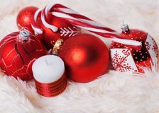 Christmas red balls on the fur background stock photography