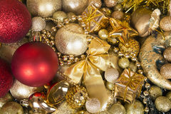 Christmas red balls on gold background. Royalty Free Stock Photo