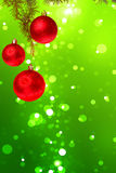 Christmas red balls with green fir tree on colorful green bokeh Stock Photos